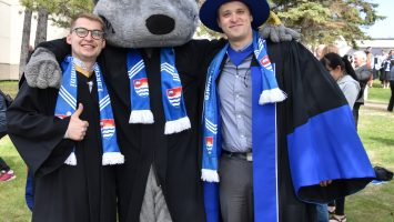 Pavlo Karasyuk (left) and Dr. Bubon (right) and LU Wolf (middle)